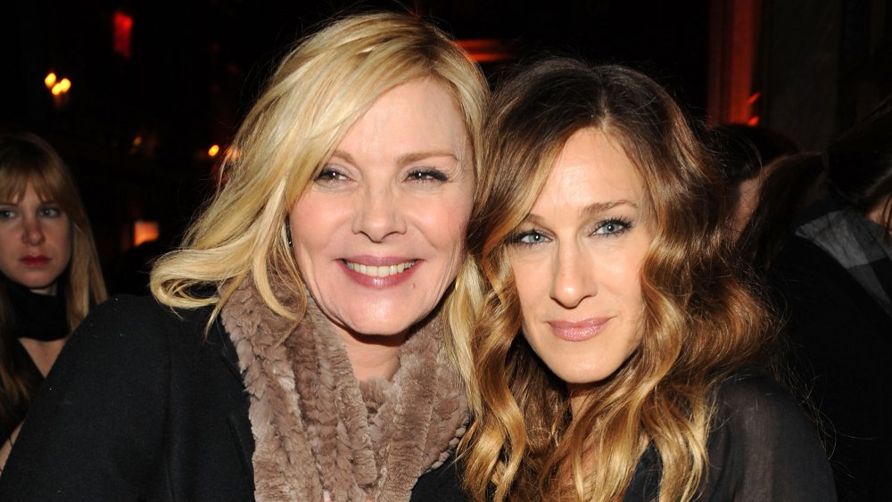 Kim Cattrall and Sarah Jessica Parker hugging and smiling