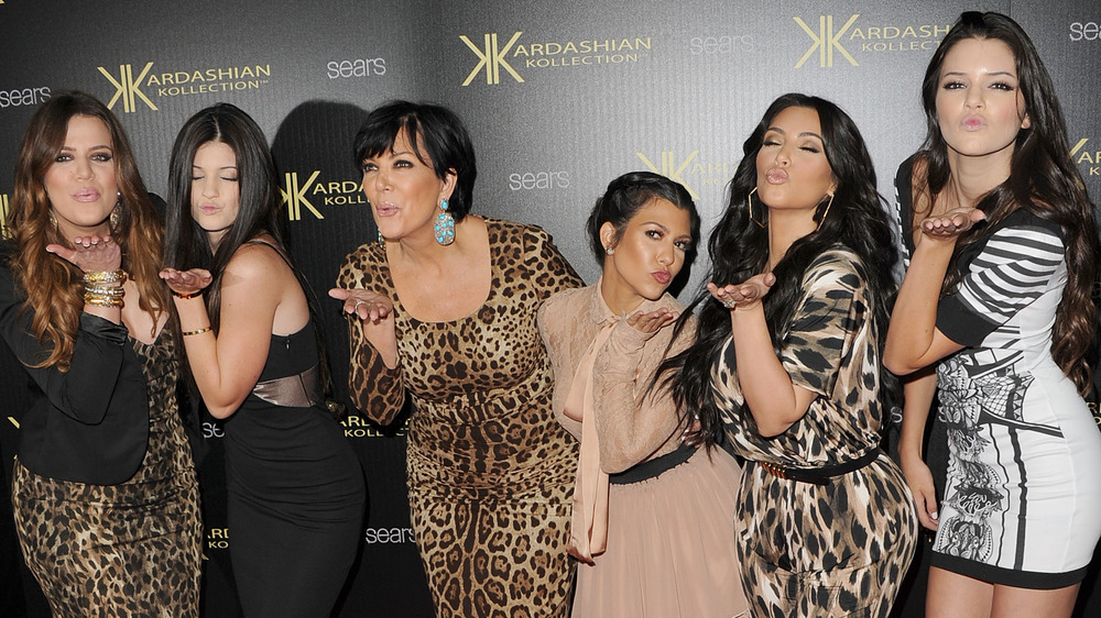 Kardashian-Jenner family blowing kisses