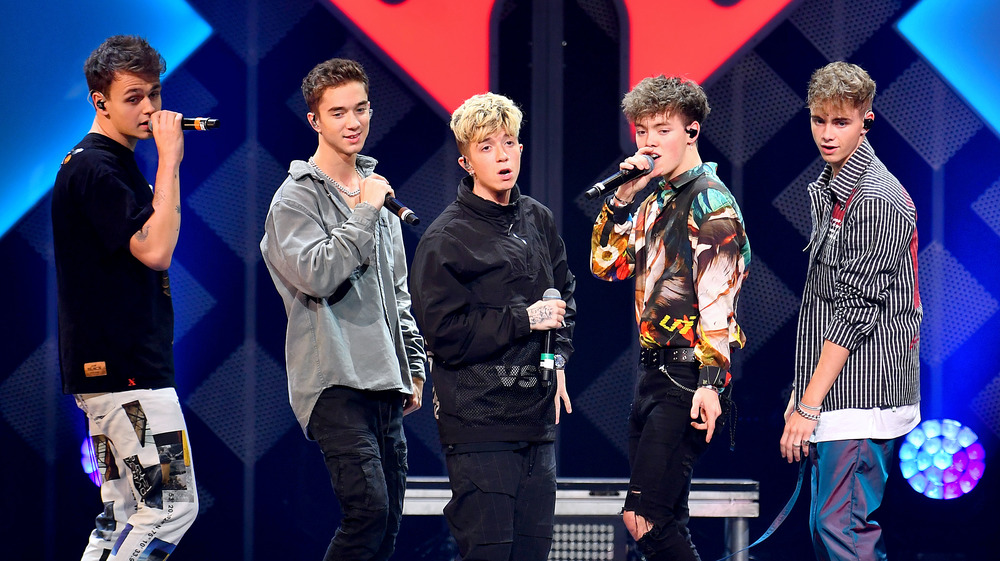 The members of the band Why Don't We onstage