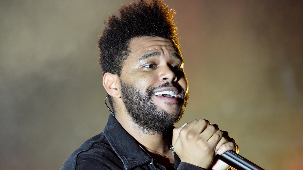 The Weeknd performing