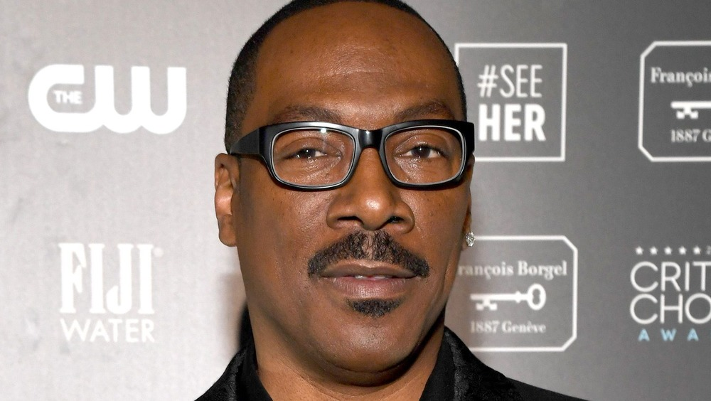 Eddie Murphy posing on the red carpet at the Lifetime Achievement Awards