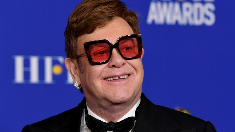 Elton John attends the 77th annual Golden Globes