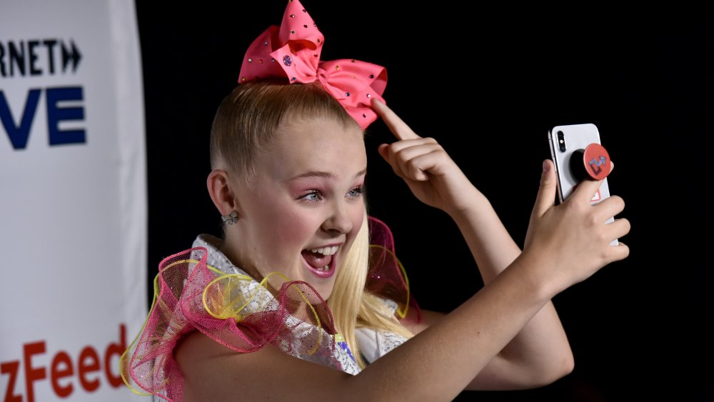 JoJo Siwa poses in one of her signature bows