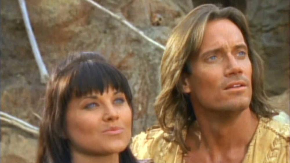 Television characters Xena and Hercules looking up