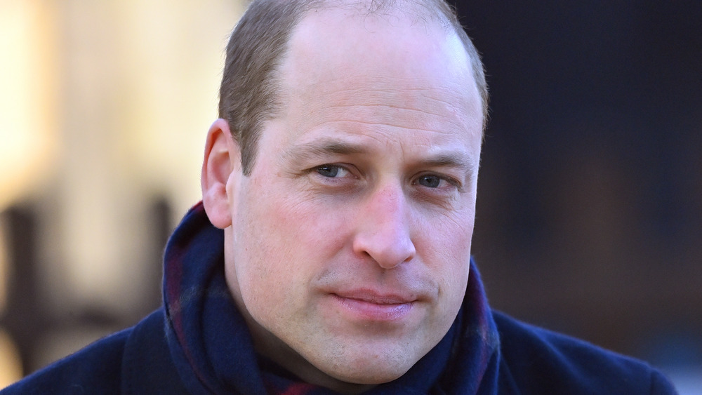 Prince William looking pensive staring off into the distance