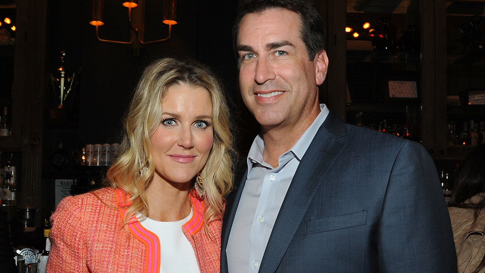 Tiffany Riggle and Rob Riggle pose together at an evening event