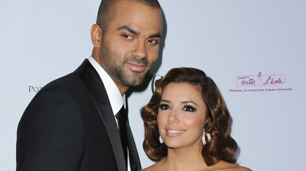 Tony Parker and Eva Longoria smiling on the red carpet