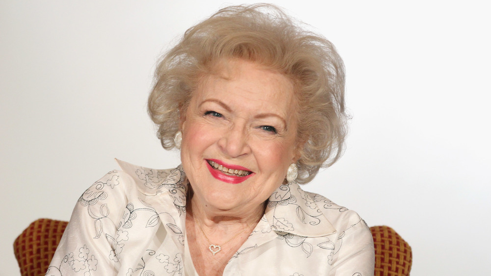 Betty White smiling at the camera for a photocall