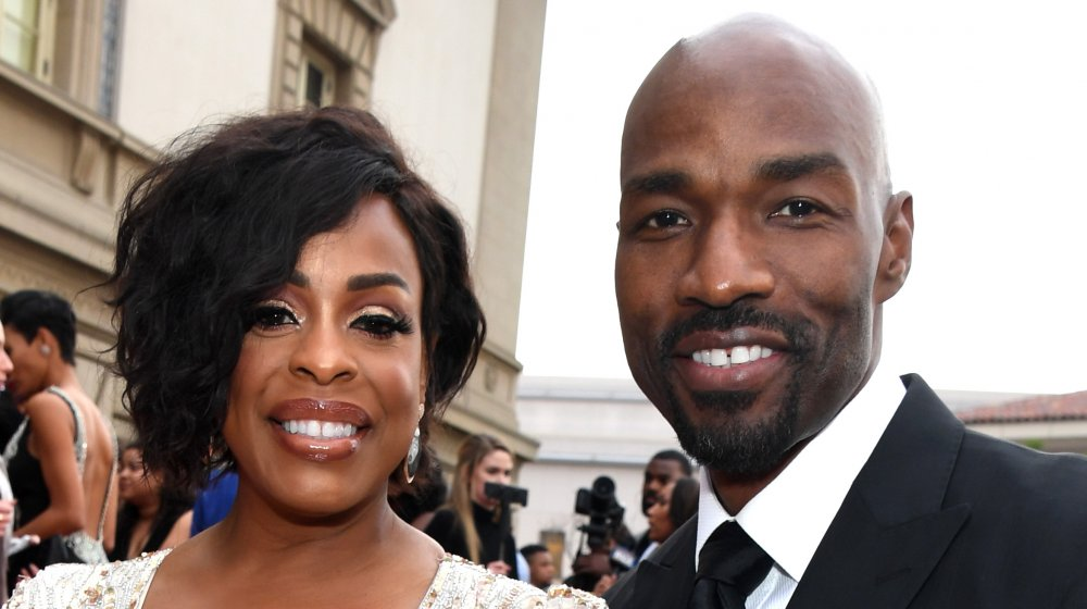 Niecy Nash, Jay Tucker smiling together at an event