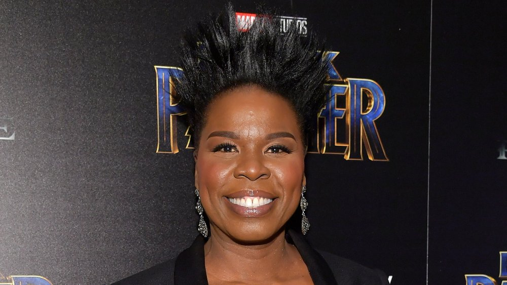 Leslie Jones smiling and posing on the red carpet