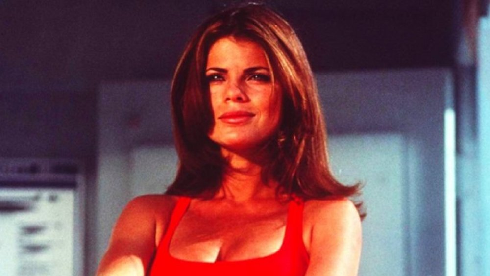 Yasmine Bleeth in a red bathing suit, playing Caroline Holden on Baywatch