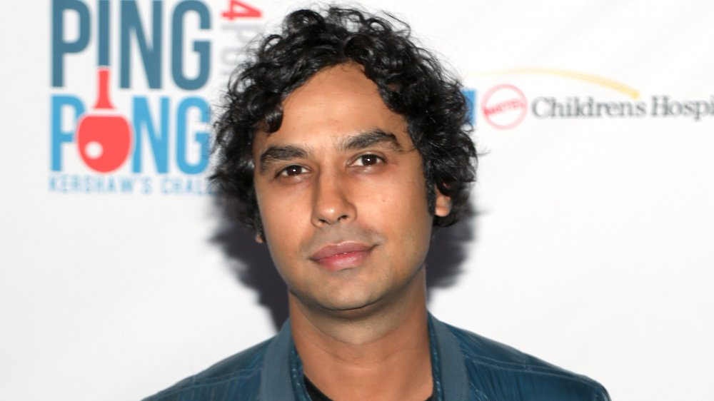 Kunal Nayyar posing with a neutral expression at a charity event