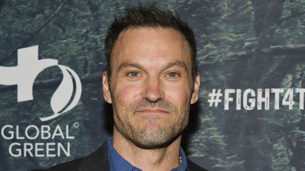 Brian Austin Green at a charity event, posing with a neutral expression