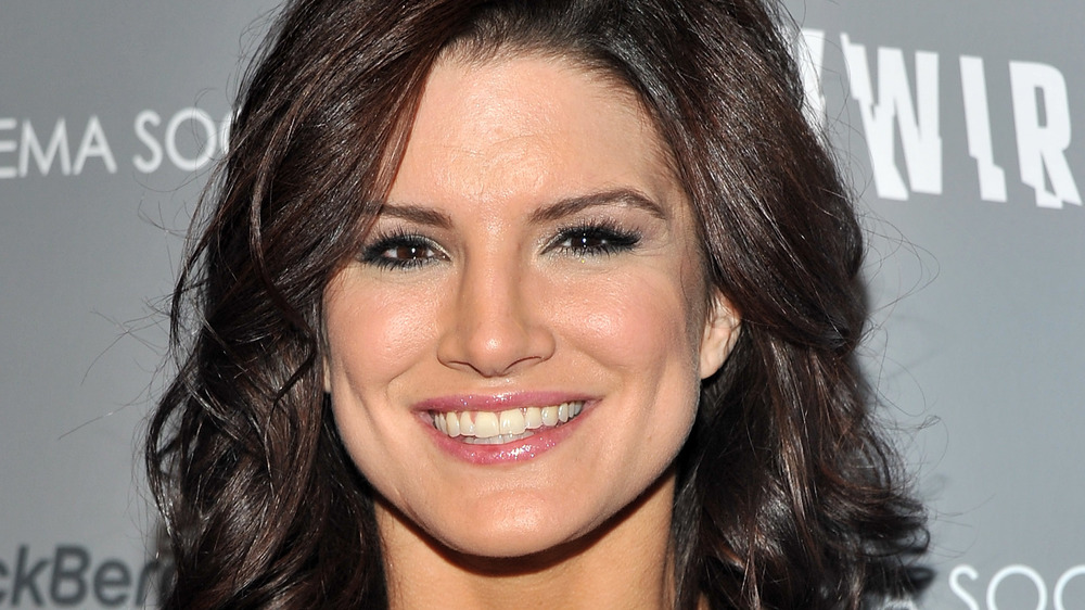 Gina Carano smiling at a screening of Haywire