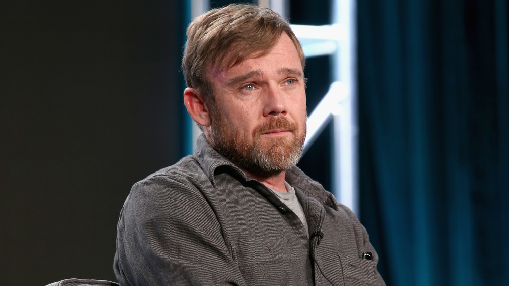 Ricky Schroder seated