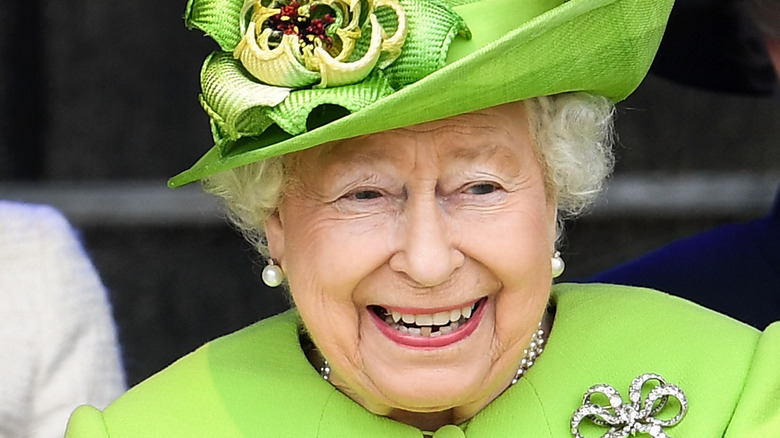 Queen Elizabeth laughing at an event