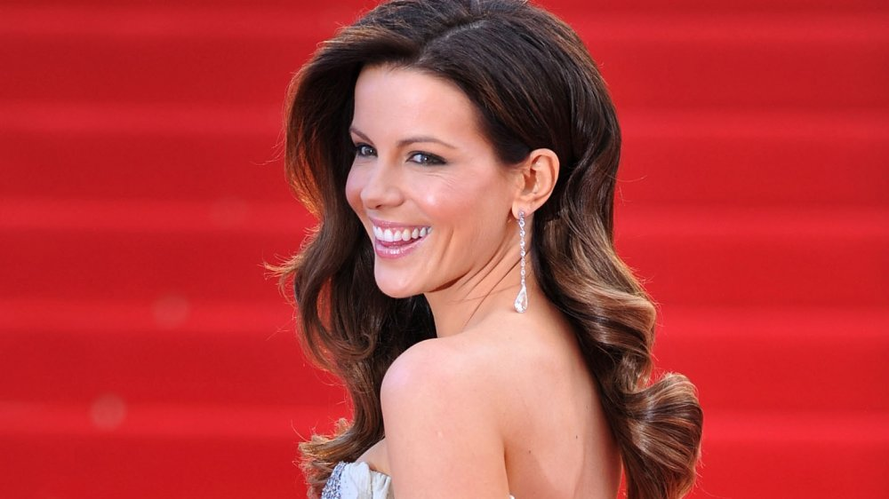 Kate Beckinsale laughing at the camera