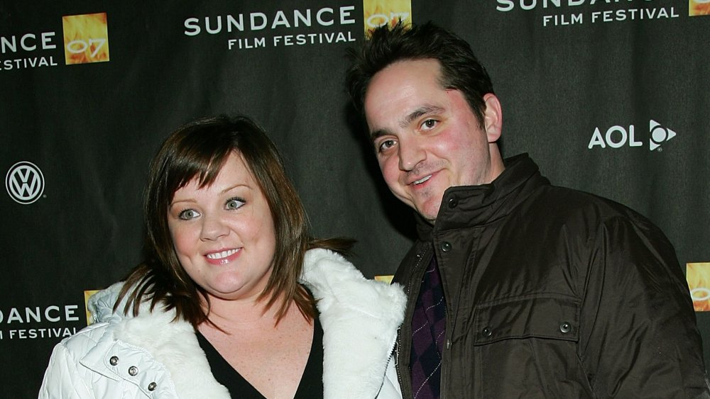 Melissa McCarthy, Ben Falcone smiling while arm-in-am at the Sundance Film Festival