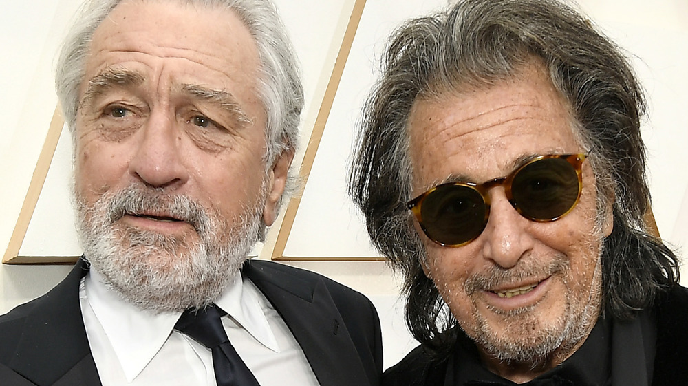 Robert de Niro and Al Pacino smile together on the red carpet