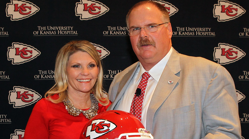 Andy Reid poses with his wife Tammy during a press conference in 2013