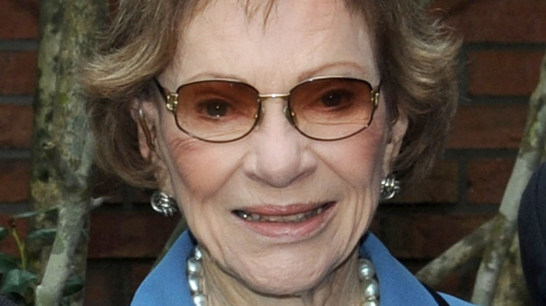 Rosalynn Carter smiling while wearing sunglasses