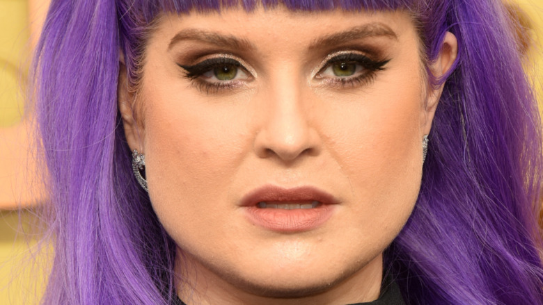 Kelly Osbourne with a neutral expression