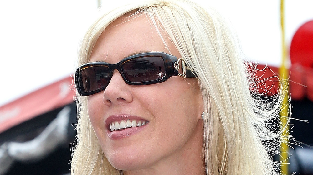 DeLana Harvick posing in sunglasses