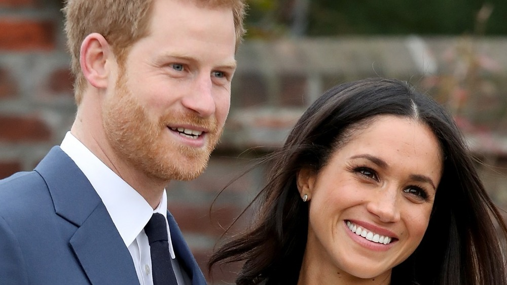Prince Harry and actress Meghan Markle during an official photocall to announce their engagement at The Sunken Gardens at Kensington Palace on November 27, 2017