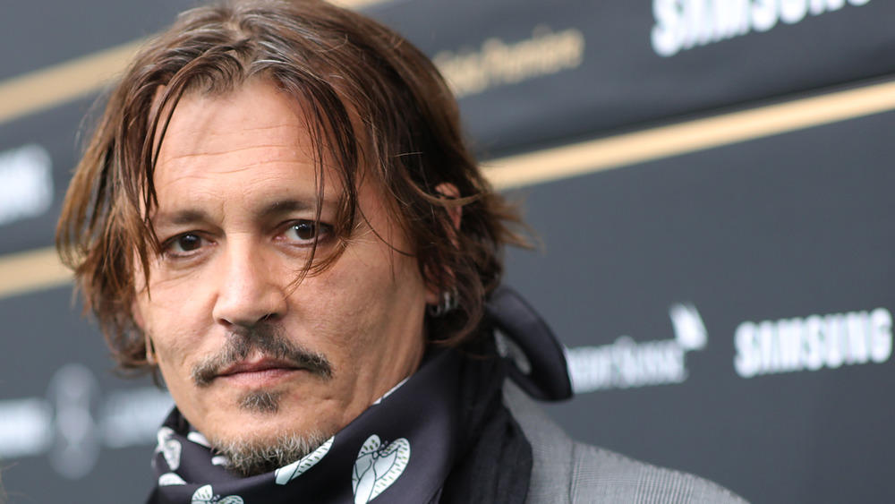 Johnny Depp wearing a scarf