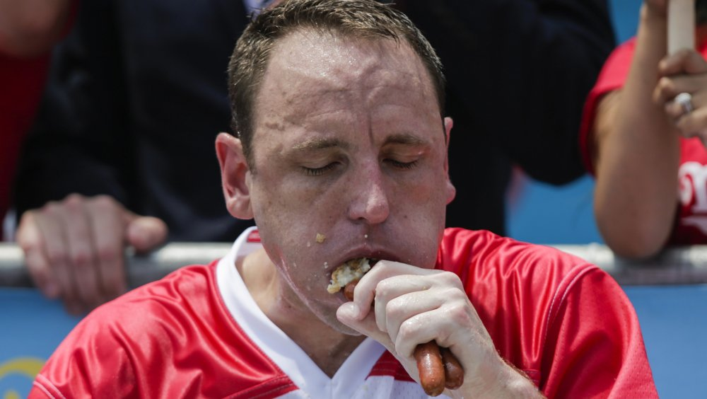 Joey Chestnut eating hot dogs
