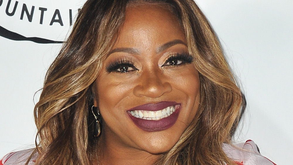 Bershan Shaw smiling for at an event