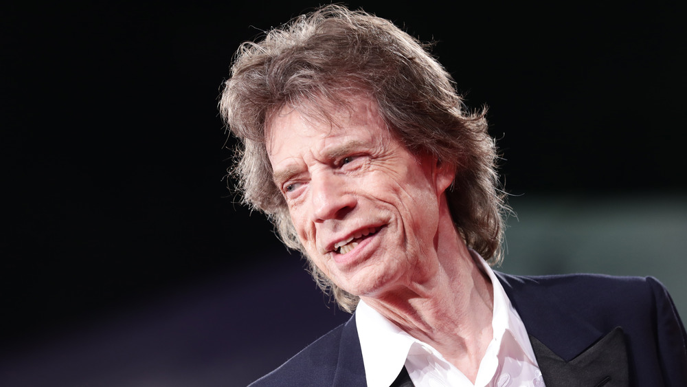 Mick Jagger looking pleased with himself