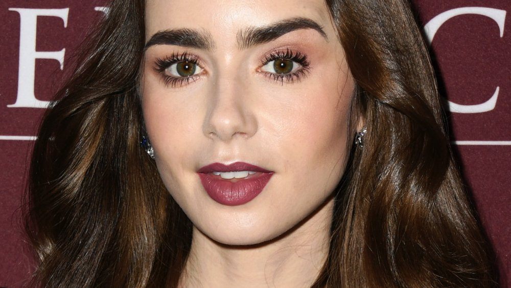 Lily Collins raising one eyebrow