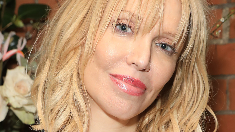 Courtney Love posing with her head tilted