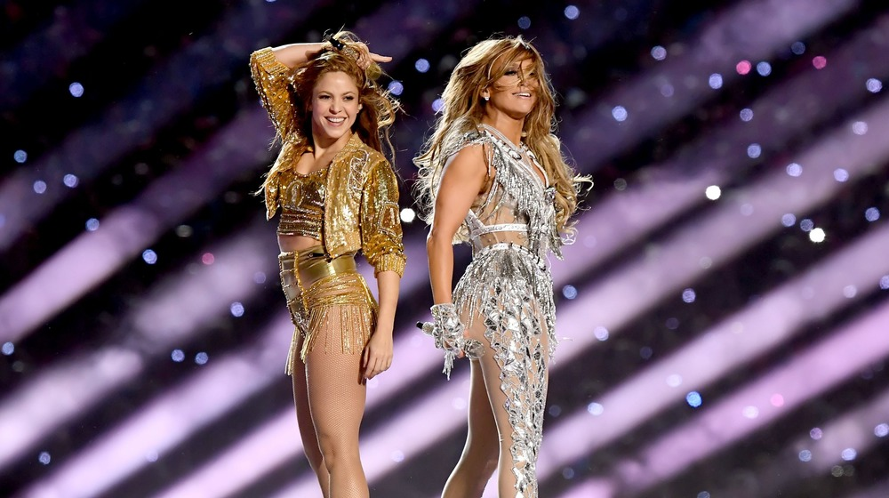Shakira and Jennifer Lopez perform on stage together at the 2020 Super Bowl halftime show