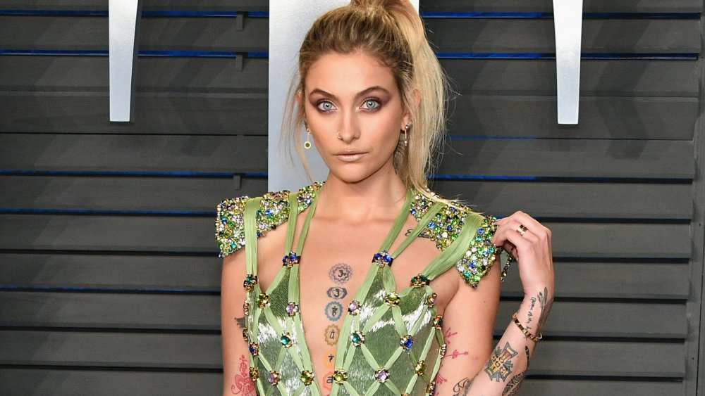 Paris Jackson in a green dress with precious gems on it