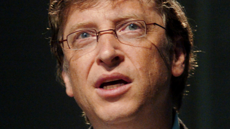 Bill Gates with a neutral expression