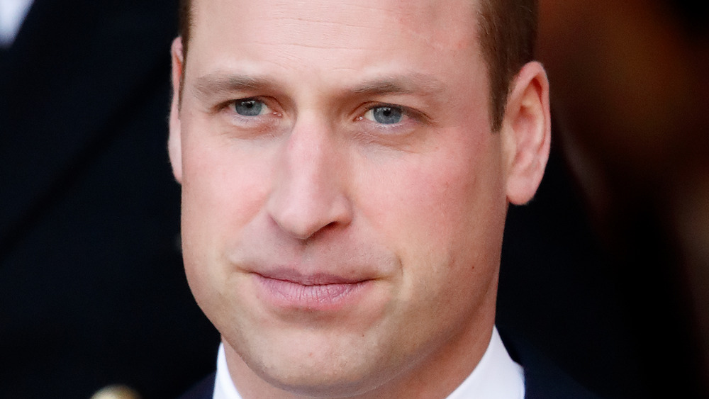Prince William staring with a serious expression