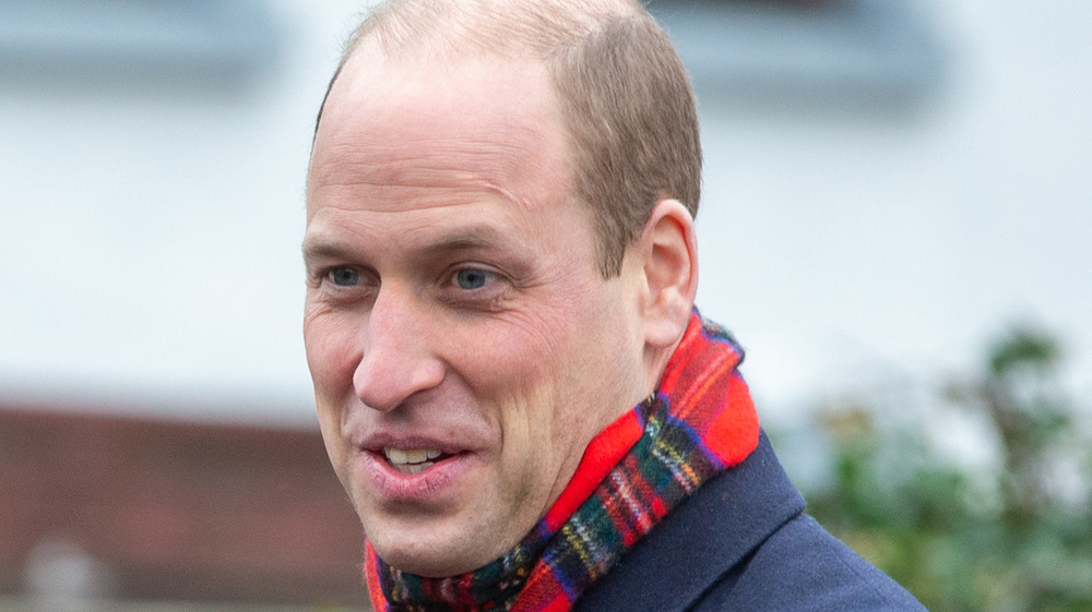 Prince William wearing a scarf outside