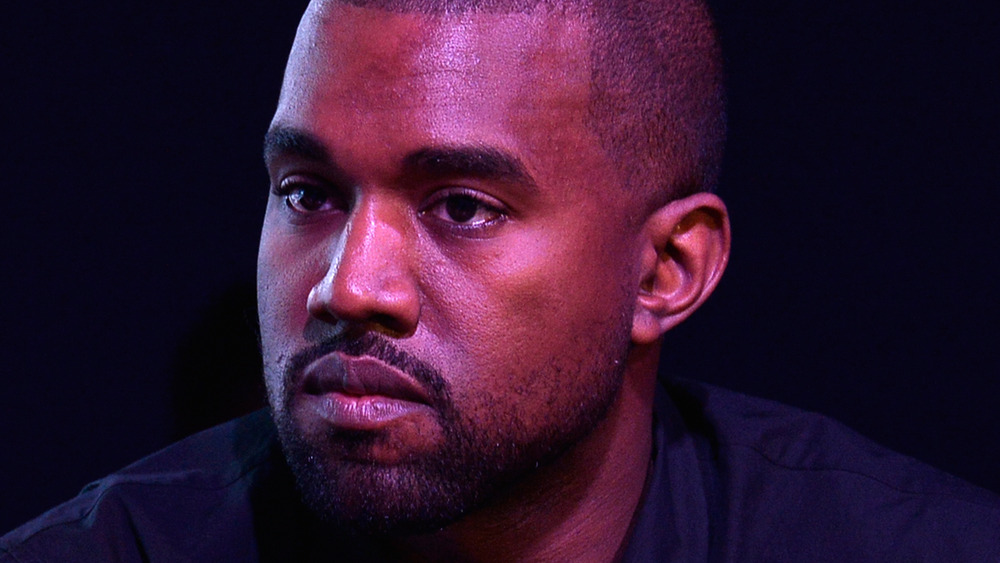 Kanye West stares off into the distance
