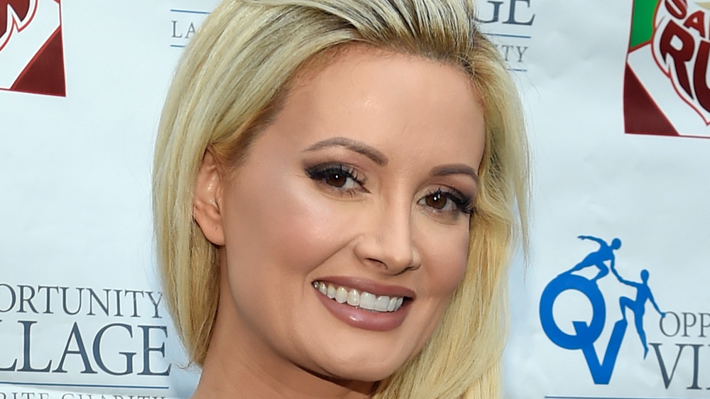 Holly Madison smiling on red carpet