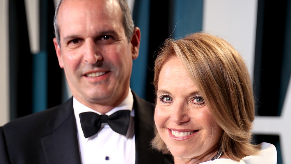 Katie Couric and John Molner smiling