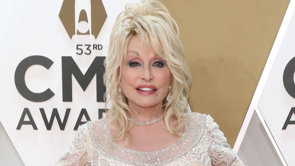 Dolly Parton posing on red carpet