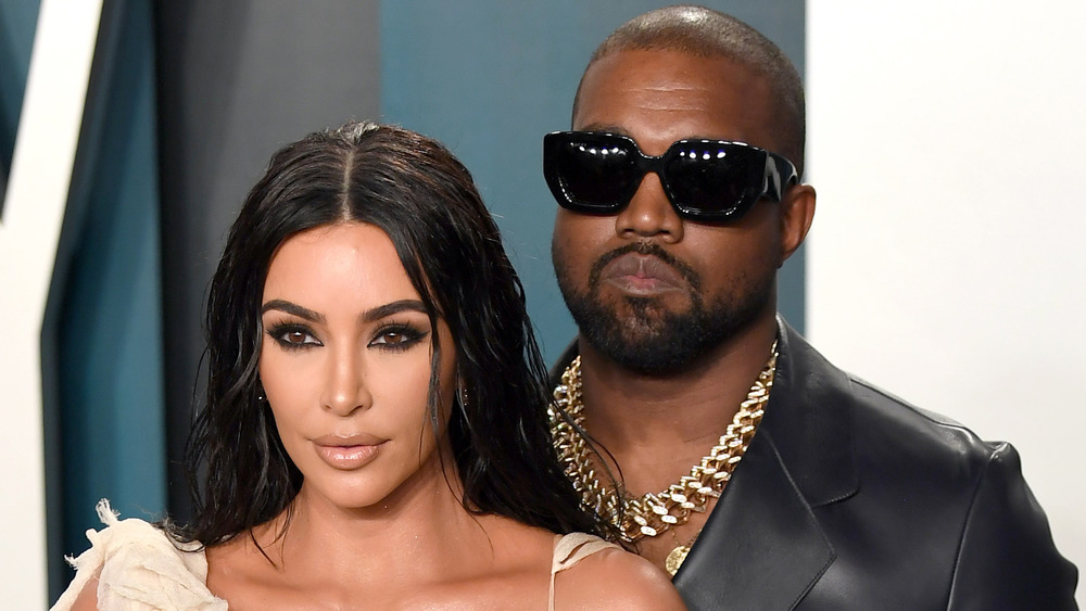Kim Kardashian West and Kanye West posing for cameras