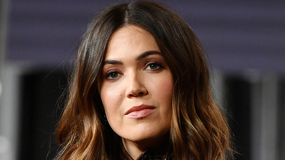 Mandy Moore looks pensively at the camera during a photo call
