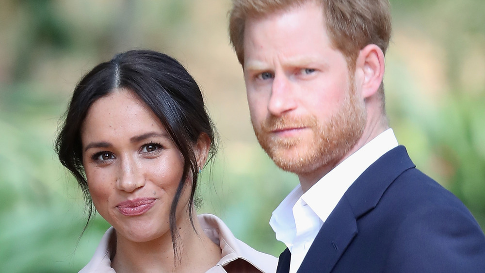 Meghan Markle and Prince Harry posing for the camera