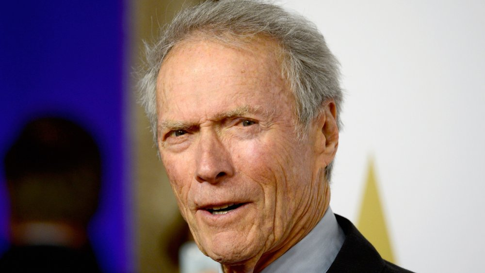 Clint Eastwood speaking with a serious expression